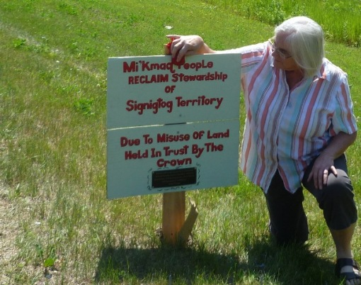 ann with reclaiming sign
